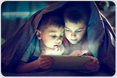 Potential dangers of too much screen time for children